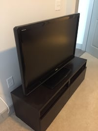 black flat screen toshiba TV with dark brown ikea wooden TV stand Watertown, 02472