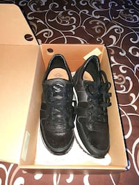pair of black Nike Air Force 1 low shoes Montréal, H4L 2X5