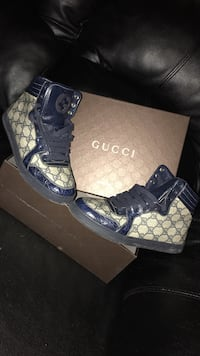 Brown-and-black monogram Gucci lace-up casual sneakers with box