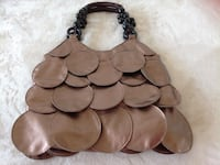 Very elegant women's brown hand spinner bag excellent conditions