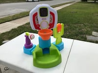 multicolored Little Tikes sports center