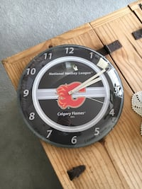 Calgary Flames Clock. Works great. Battery operated.  Cochrane, T4C 1K6