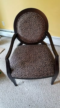brown wooden framed black and brown leopard print armchair