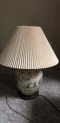 white and brown floral table lamp