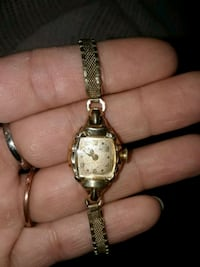 gold-colored analog watch London, N6A 1B8