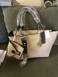 women's brown Michael Kors tote bag