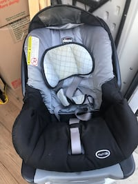 Baby's black and gray car seat carrier and stroller
