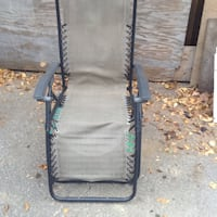 black metal frame with gray padded folding chair