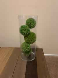 Glass vase with decorative grass balls