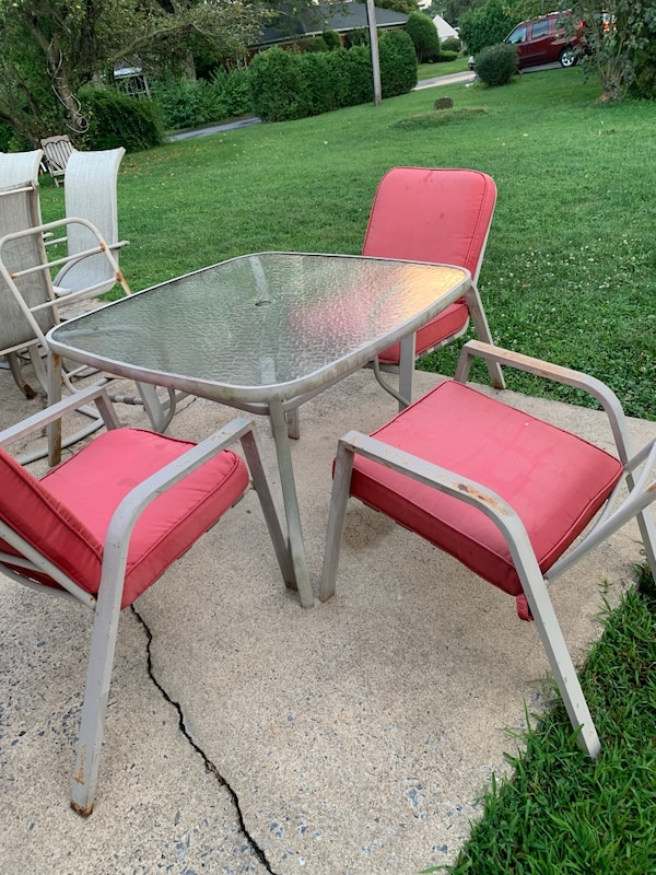 Patio table and 4 chairs (cushions sold, just table and chair now)