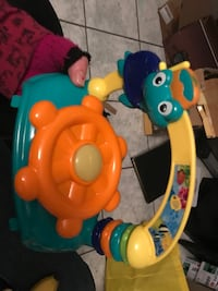 yellow, teal, and brown plastic toy