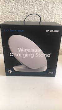 Black and white tp-link wireless charging stand 2271 mi