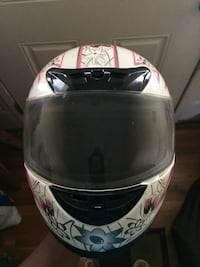 white, pink, and black floral full face helmet 56 km
