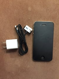 Black iphone 4 with charger