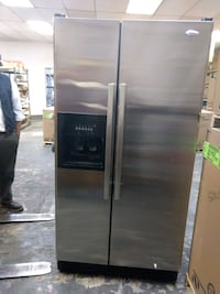 gray side-by-side refrigerator with dispenser North Las Vegas, 89030