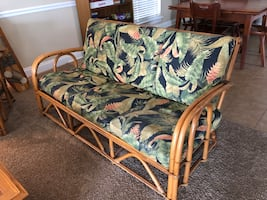 Vintage 1950s rattan furniture. Two sofas, two chairs w/ cushions.
