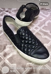 pair of black leather slip-on shoes London, N5W 6E3