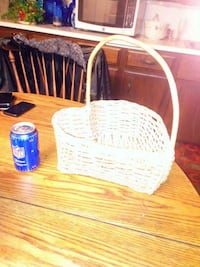 blue beverage can and brown wicker basket