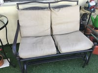 Metal swinging patio love seat