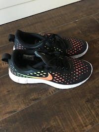 Pair of black-and-white nike running shoes Toronto, M4R 1E4