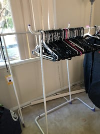 2 white hanger racks with about 100 free plastic hangers LOSANGELES