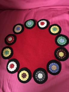 red, green, brown, and yellow floral mat