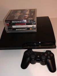 Ps3 with 5 games and controller  Montréal, H1R 2B6