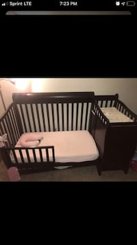 Brown crib/toddler bed with matching dresser