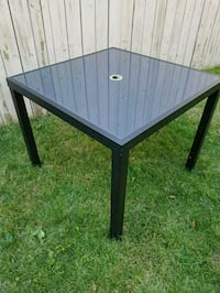 Square black glass patio table