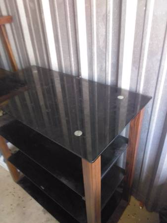 black glass top table with brown wooden frame