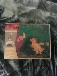 Puzzles 5 in one Lion King puzzles it still in the package never open
