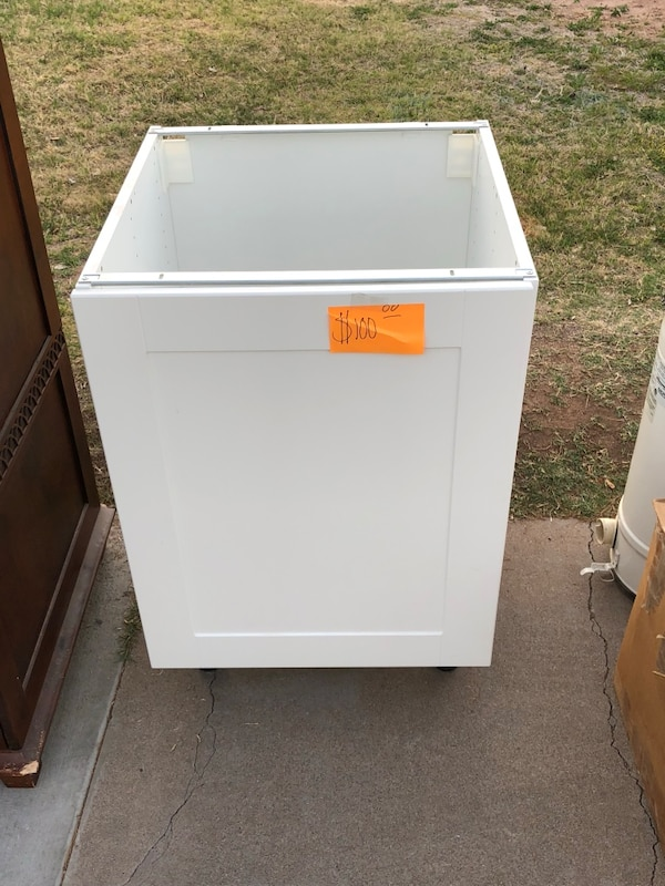 IKEA cabinet for laundry room, never used, add sink or counter top to  complete  Dimensions are 33 inch tall 2ft wide by 2 ft depth  Interior  space for