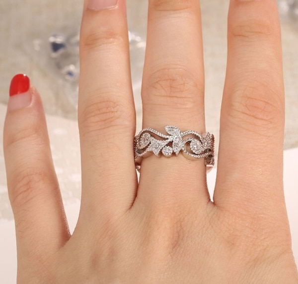 Silver band ring with diamonds.