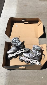 pair of gray-and-black inline skates with box Ottawa, K2M 0H2