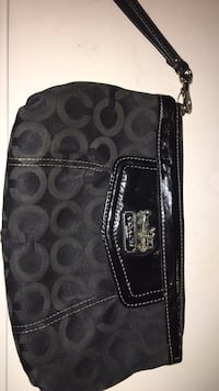 women's black Coach bag