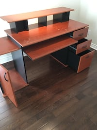 brown wooden knee hole desk