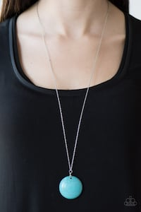 women's silver-colored necklace with round pendant