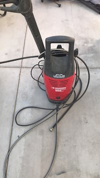 red and black Husky pressure washer
