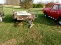 brown and white utility trailer