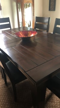 Rectangular brown wooden dining table @ 6 chairs comes with the China cabinet next to it for $1900 price Liverpool, 13088