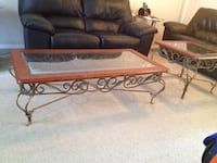 brown and black wooden framed glass top coffee table