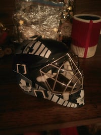 Mini goalie mask autographed by Johnny Bauer