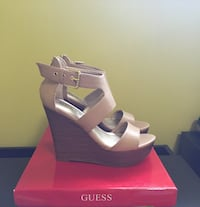 Women's pair of brown Guess wedge sandals