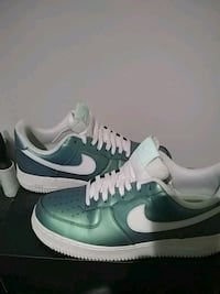 pair of white Nike Air Force 1 low shoes Arlington, 76013