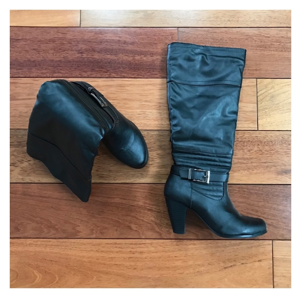 New Pair of black boots size 6