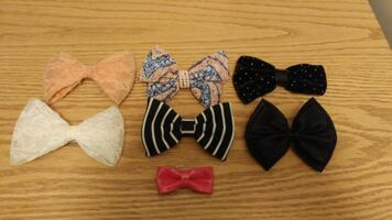 Must go! Bowtie hair clips. New. Located in Simcoe. Pickup only.