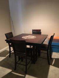 Rectangular brown wooden table with four chairs dining set Bossier City