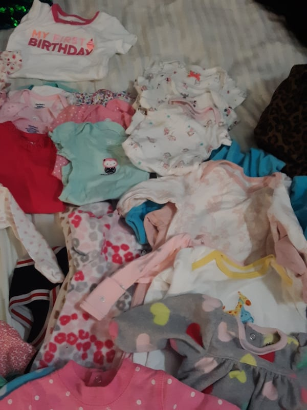 Box of baby clothes 530d55da-f883-4089-8c97-0ff7d30a644a
