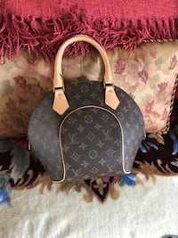 NWOT designer purse , purchase it from here for $90 Ajax, L1S