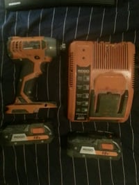 orange and black cordless hand drill in case Edmonton, T5M 3A1